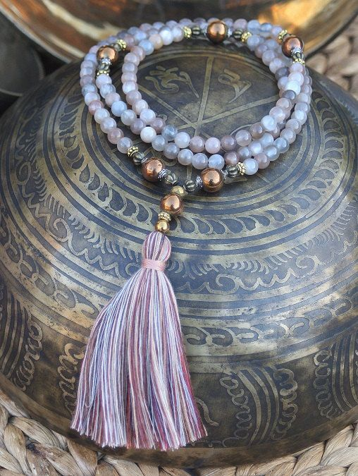 Mala necklace made of 108, 6 mm - 0.236 inch, beautiful sun- and moonstone gemstones and decorated with hematite. Because the mala is strung on elastic this piece can also be worn as a wrist mala bracelet - look4treasures on Etsy