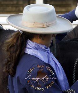 A wide brimmed ladies western hat.