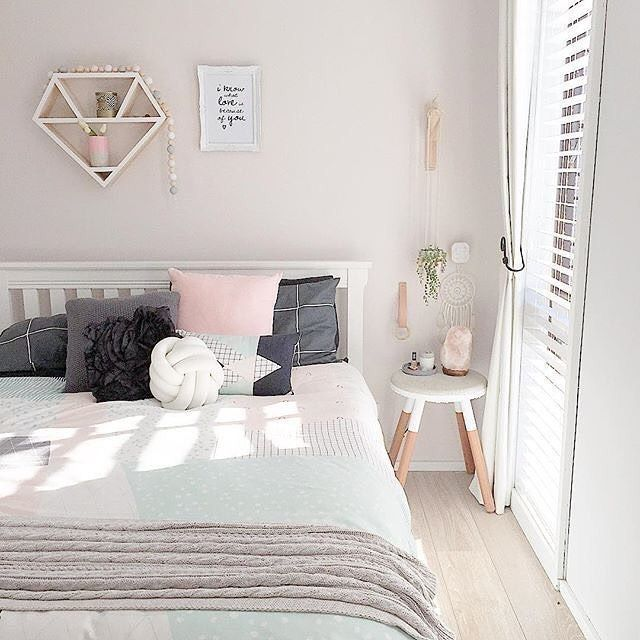 Airy copper and white bedroom.