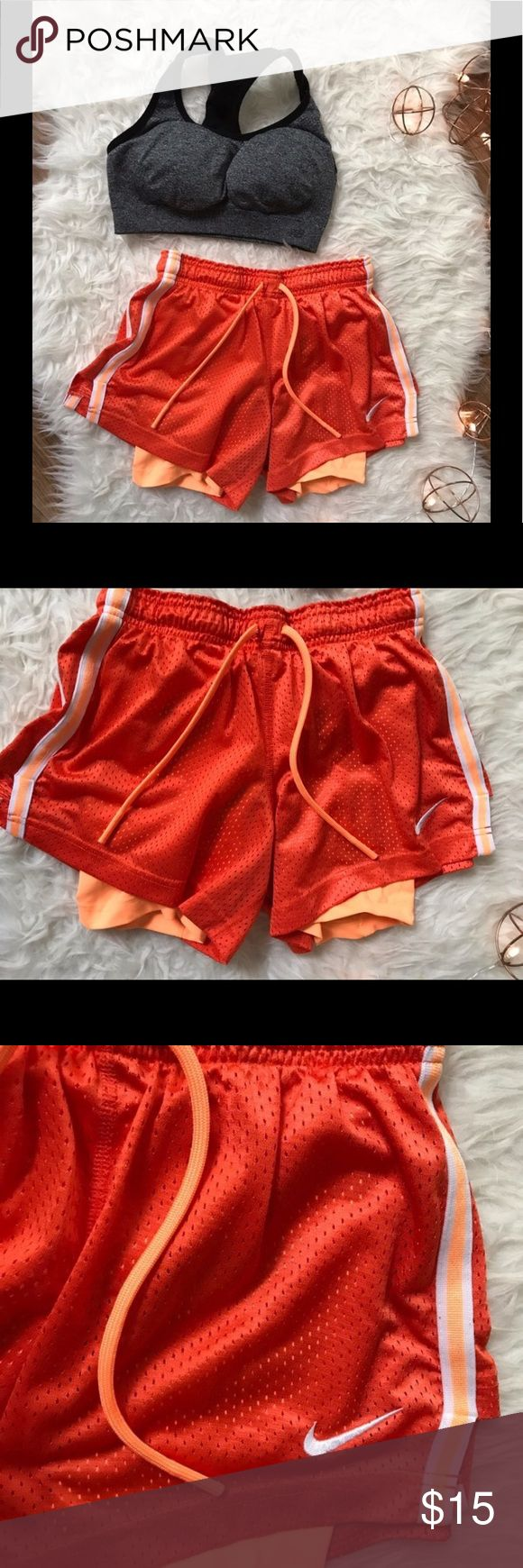 Nike Dri-Fit Shorts Orange running shorts. Worn maybe three times. Need new home. Help me out :) super comfy, I love the dri-for with the compression shorts built in personally cause my butt and underwear don't show when I'm weight lifting at the gym and all them creepy boys be creeping ;) you know what I mean...   #nike #nikedrifit #nikedrifitshorts #orangenike #runningshortswithcompressionshortsunder  #compressionshorts #justdoit Nike Shorts