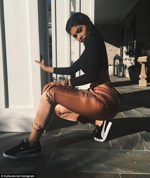Saucy suede: Kylie Jenner gave fans another look at the latest sneakers in her Puma range on Thursday and also gave them a good look at her mind blowing proportions