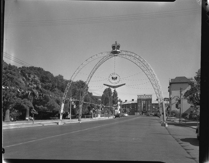 113698PD: Ceremonial arches decorate St George's Terrace, Perth for the visit of HM Queen Elizabeth II, 3 April 1954. https://encore.slwa.wa.gov.au/iii/encore/record/C__Rb3598029