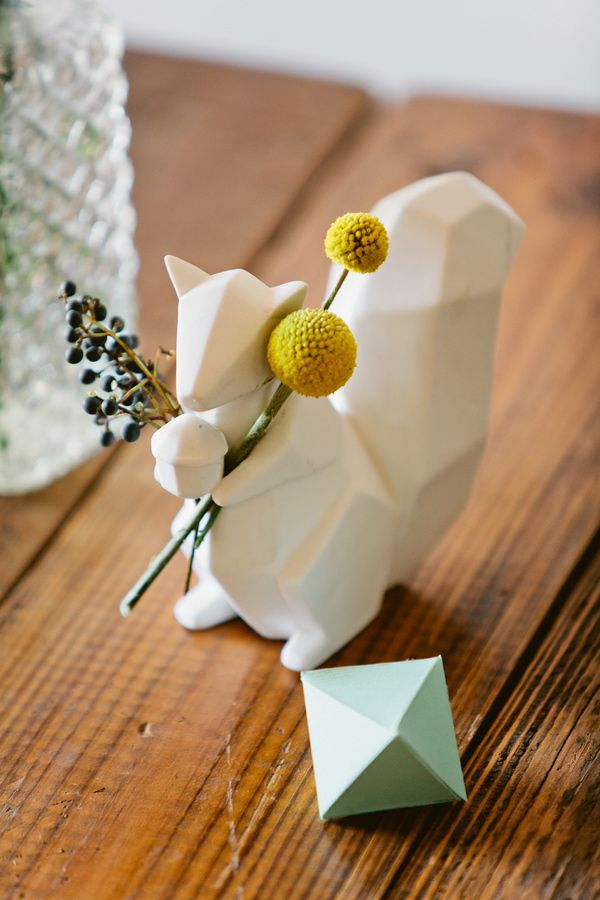 Modern Geometric Urban Wedding---Cute little animals holding flowers at the table. Yes Please