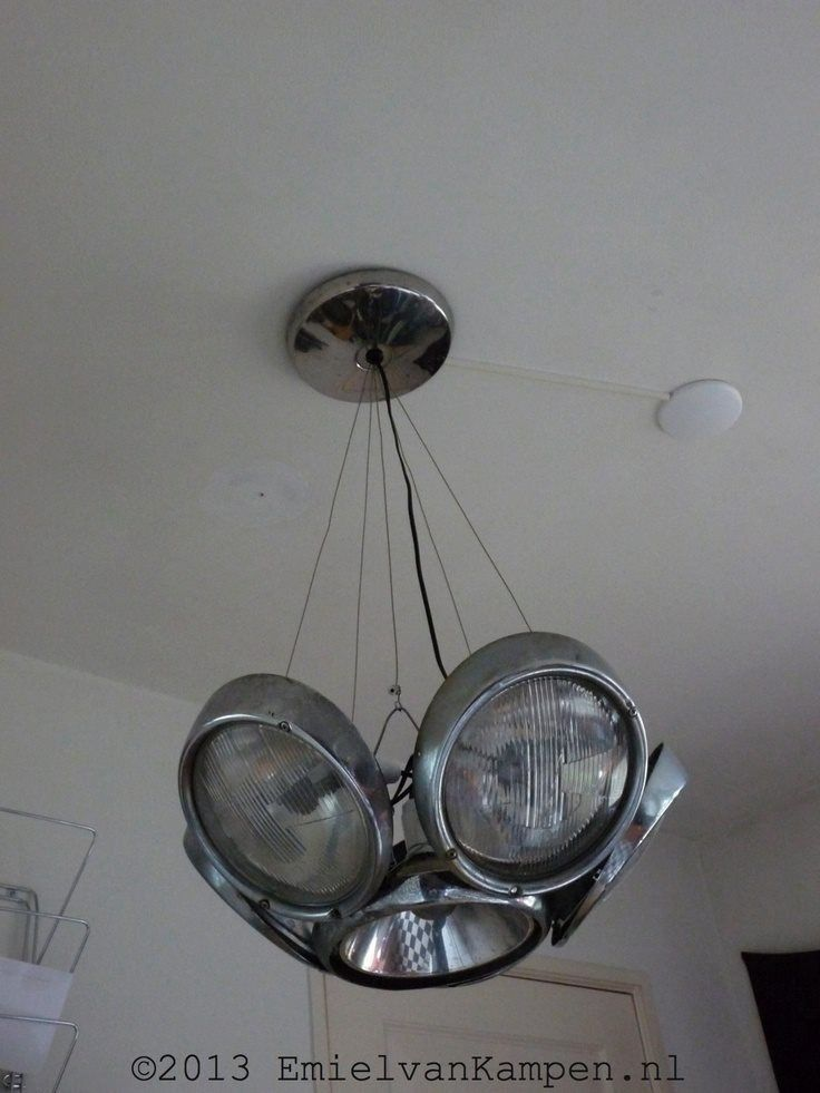 Old vintage style headlights as a overhead light for a room.