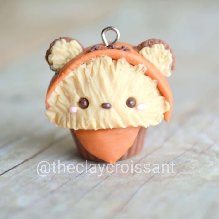 """Ewok cupcake I had mixed feelings when I was first introduced to these furry creatures as a kid. I remember thinking, """"they're adorable!... But they're kinda creepy.... But still kinda adorable!... But still creepy."""" And I used to keep my toes tightly tucked underneath me while watching Star Wars because I feared that Darth Vader would grab my feet from under the sofa. ----------------------------------------------------------------------------#polymerclay #claycharms #clay #cha..."""