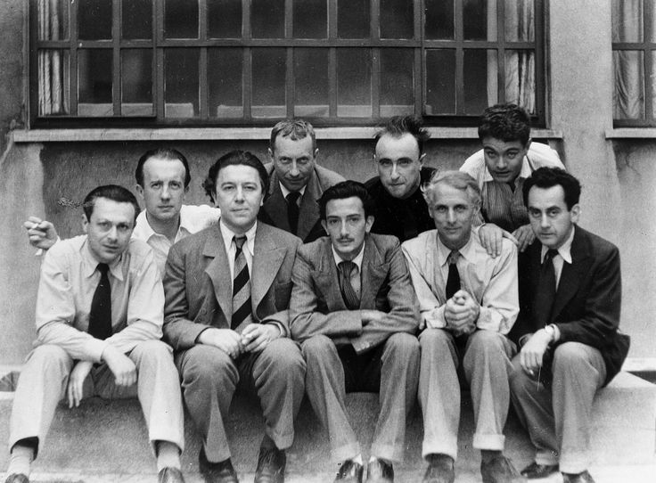 The Paris surrealists, 1933: Tristan Tzara, Paul Éluard, André Breton, Hans Arp, Salvador Dalí, Yves Tanguy, Max Ernst, René Crevel and Man Ray.  Photo by Anna Riwkin-Brick (there are several photographs of this group)