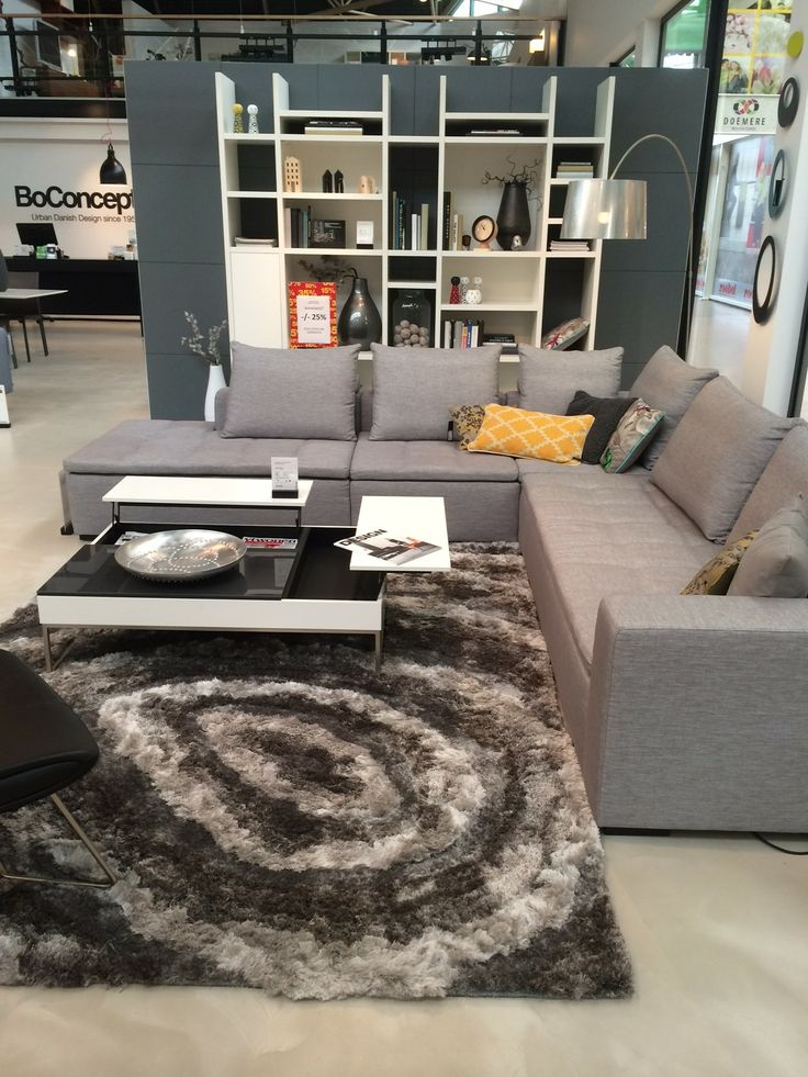 BoConcept Mezzo sofa, Chiva coffee table, Lecco wall system, and Adventure rug