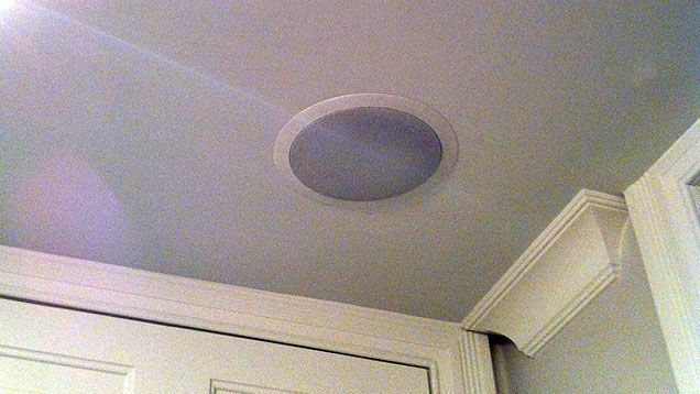 The cleanest whole home audio and home theater setups are those with speakers embedded in the walls and ceilings. Here's how to hide your speakers and retain great sound. #homeaudioinstallation