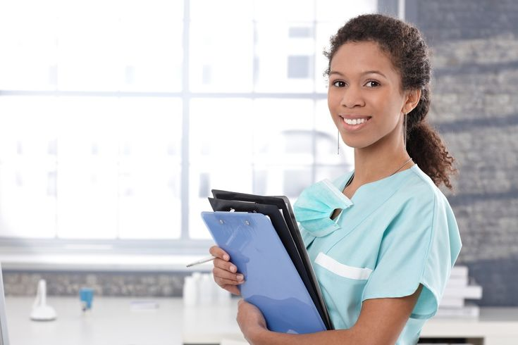 Happy medical worker with case sheets