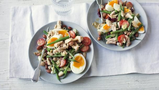 """Similar to a tuna Nicoise, this salad has the addition of canned beans for extra fibre. Use drained and rinsed red kidney beans if you can't find mixed beans.  With a GI of 50 this meal is <a href=""""http://www.bbc.co.uk/food/collections/high-protein_low-gi_recipes"""">high protein, low GI</a> and  provides 390 kcal per portion."""