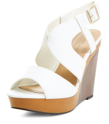- Open toe design- Cut out detail- Wooden wedge- Wedge height: 4.5