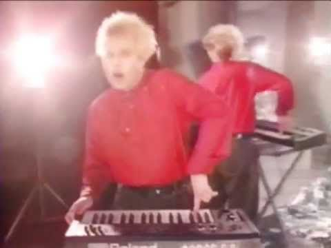 FLOCK OF SEAGULLS singing I RAN - From the original 80s video 45. Digitally enhanced video, remastered, audio HQ from the CD. True aspect ratio, not fake widescreen. For 50 years motion pictures were missing half their picture when converted to TV standards. Now people are doing the same thing in reverse to TV videos!