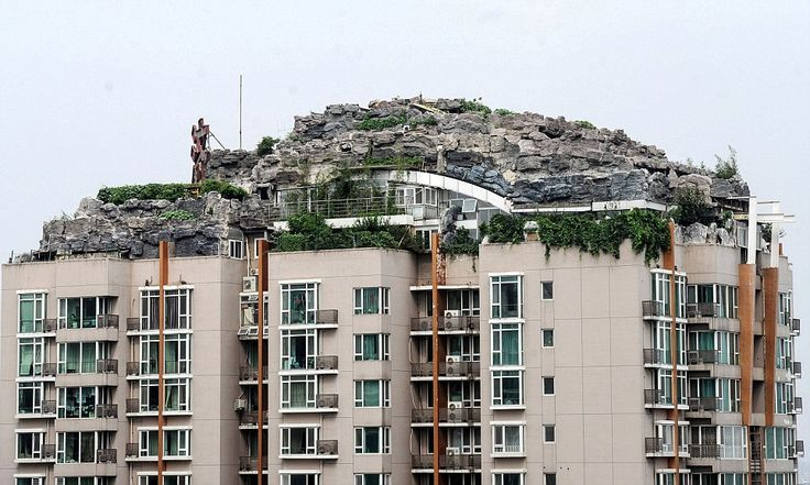 Professor Zhang Lin has spent six years shifting rocks and rubble to the roof of his Beijing apartment block to build his dream 'mountaintop' penthouse (and the people living below aren't too happy)