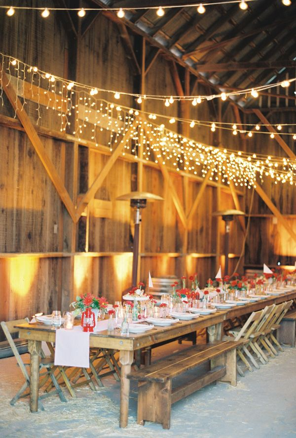 Old barn and long table for wedding reception.