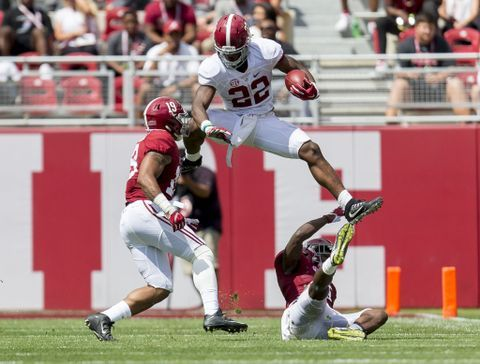 Alabama running back Najee Harris (22) hurdles Alabama defensive back Shawn Jennings (19) and Alabama defensive back Hootie Jones (6) during the first half of Alabama's A-Day 2017 spring football game, Saturday, April 22, 2017, at Bryant-Denny Stadium in Tuscaloosa, Ala.  Vasha Hunt/vhunt@al.com