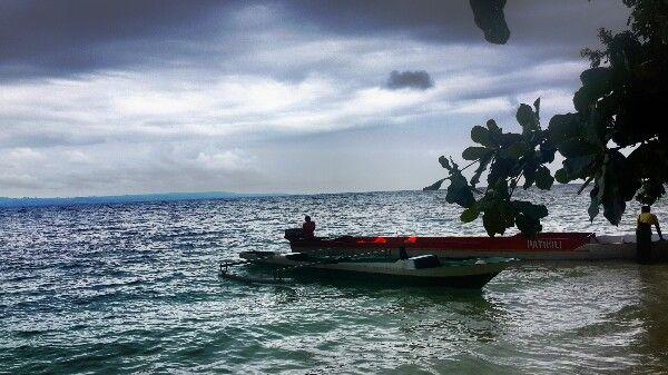 """When the sun is hiding"" - Ora Beach, Maluku - Indonesia"