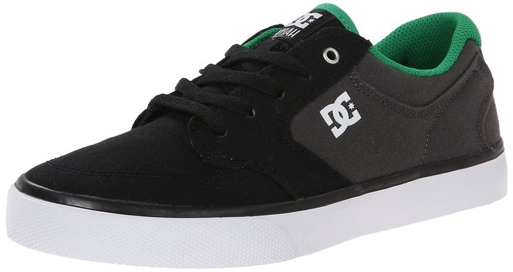 DC Nyjah Vulcanised TX Skate Shoe (Little Kid/Big Kid), Black/Grey/Green, 11.5 M US Little Kid. Low-top shoes. Nyjah Huston's signature Vulc model. Textile Upper. Clean toe with decorative stitching & perforation details. Molded TPR logo.