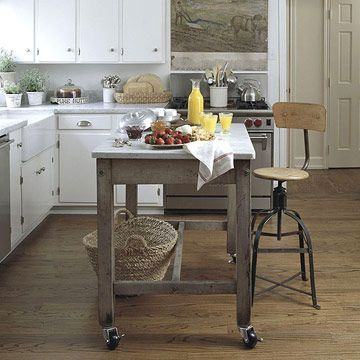 Convert a Work Table        Add casters I love casters...even on elegant pieces..) to the legs of an old work table to make a portable kitchen island. A slab of marble on top makes a perfect surface for food prep. Check local listings for STONE  REMNANTS that you can use for your island.