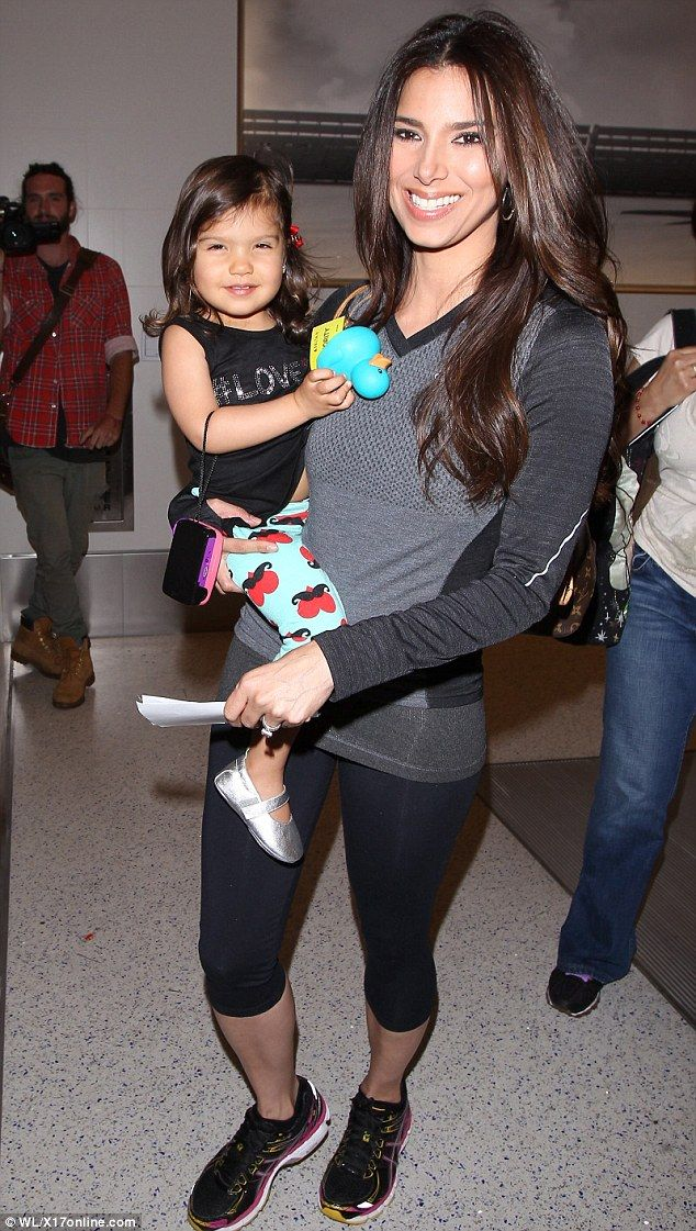 Makeup mommy: Roselyn Sanchez wore her war paint as she carried daughter Sebella through an LA airport on Tuesday