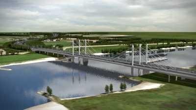 Artist impression van de toekomstige situatie, in vogelvlucht vanaf noord-westdijk richting A50 waalkruising. De huidige Waalbrug en de extra Waalbrug, die nu gebouwd wordt, liggen als een identieke tweeling naast elkaar over de rivier de Waal. Beide oevers zijn ook te zien.