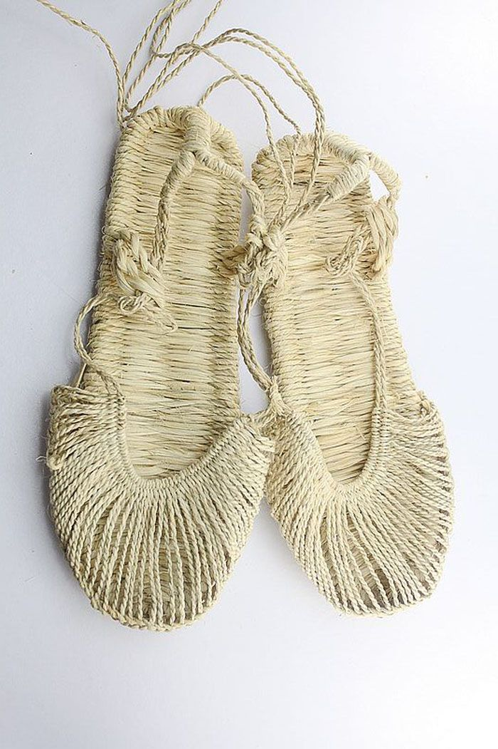 Delicate woven slippers/shoes. These would look lovely displayed on a coffee table.