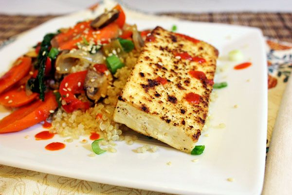 Sesame-Ginger & Sriracha Vegetables with Tofu:  Spice it up with Sriracha in a zesty asian-style vegetarian dish