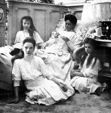 Grand Duchesses Anastasia sitting next to her Mother Empress Alexandra, Grand Duchesses Tatiana and Marie sit on the floor.
