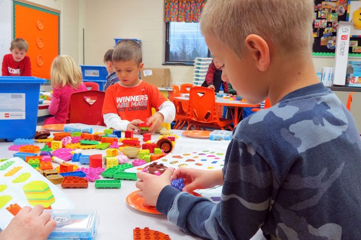 Kindergartners are focused on their task at hand to build Mrs. Cramer a unique Thanksgiving dinner with LEGOs.