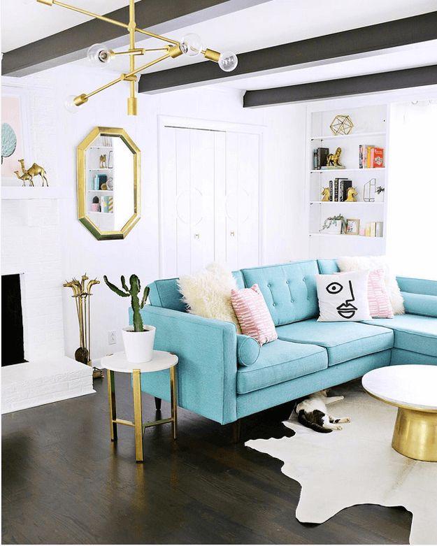 living room with turquoise sectional sofa, mid-century modern interior, pantone island paradise, light turquoise, sky blue, baby blue, caribbean blue, aqua blue, tiffany blue, gold accents, dark wood floor, dark wood beams