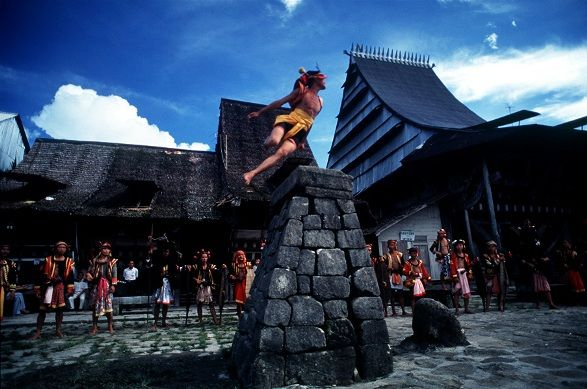 Hombo Batu, Nias Tribe (Southern Nias, Indonesia) - The skipping stones tradition. The stones are composed; 2 meters height dan 40 centimeters thickness. This tradition is held to test the agility and the maturity of their youth.