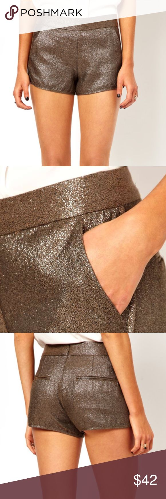 French Connection Metallic Shorts - Size 4 The perfect shorts for a night out. Can be dressed up or down. The copper color is neutral and pairs equally well with black or white. I've also worn them in the winter layered over black tights! The shorts for true to size - the leggy (and presumably very tall) model is making them look shorter than they actually are - as in, your butt check won't be shown. Has both side and back pockets. French Connection Shorts