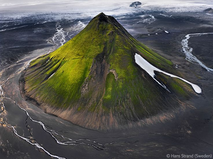 The great Maelifell by Hans Strand. The Maelifell volcano  towers over Iceland's massive Myrdalsjökull Glacier.