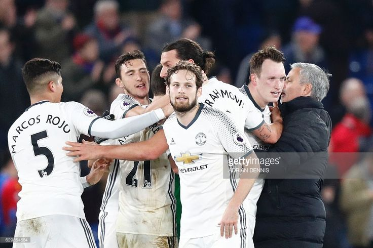 Manchester United's Portuguese manager Jose Mourinho (R) congratulates his players following the English Premier League football match between Crystal Palace and Manchester United at Selhurst Park in south London on December 14, 2016. / AFP / Adrian DENNIS / RESTRICTED TO EDITORIAL USE. No use with unauthorized audio, video, data, fixture lists, club/league logos or 'live' services. Online in-match use limited to 75 images, no video emulation. No use in betting, games or single…