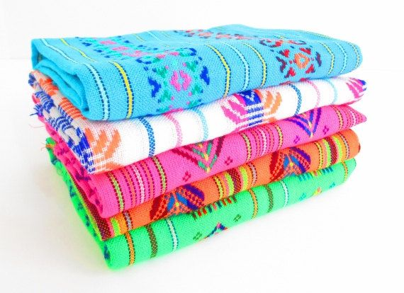 Colorful fabric from Mexico featuring geometric details and bright colors. This…
