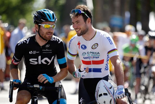 Sir Bradley Wiggins (L) of Great Britain riding for Team Sky talks with Mark Cavendish of Great Britain riding for the Omega Pharma-Quickste...