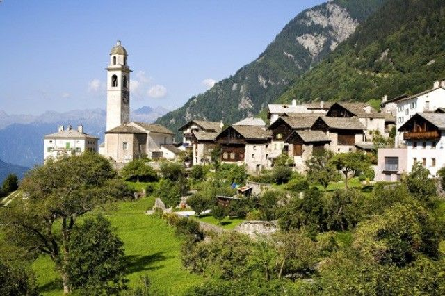 (Rex) Ten Secret European Villages: Soglio, Switzerland (Soglio in the canton of Graubünden, close to the Italian border, is one of Switzerlands most romantic and traditional villages, famous for its flowers. Located on a sunny mountain terrace with amazing views, Soglio is home to a baroque rose garden and sequoia trees. The locals speak Italian but also their local Lombard dialect. Stay at Palazzo Salis, which was nominated Swiss Historic Hotel of the Year in 1998.)