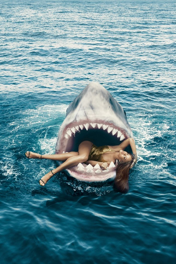 Gracing the March 2015 cover of Harper's Bazaar US, Rihanna glitters in gold. But inside the magazine, things get a bit more dangerous as she swims alongside sharks and even poses in a shark's mouth for one shot. Norman Jean Roy captured the photo shoot with the pop star. When asked in the interview about her greatest adventure thus far, the