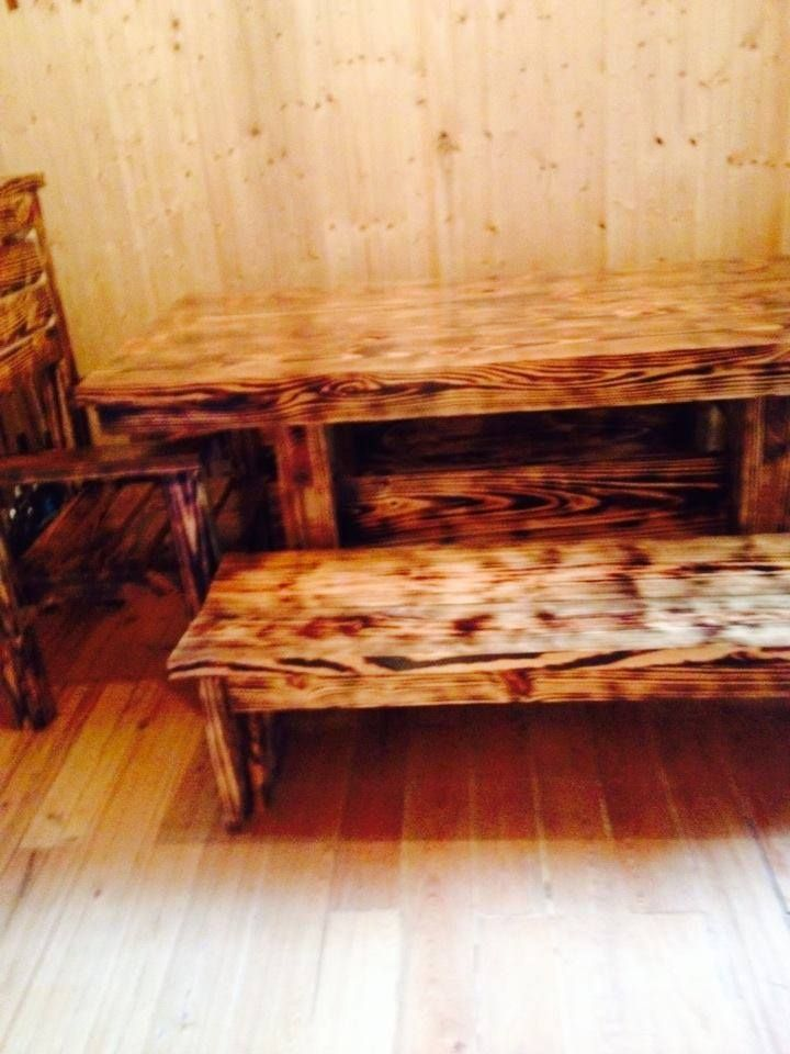 yellow pine table with chairs and benches