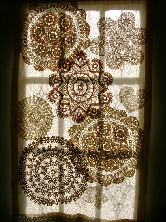 A curtain made of muslin and crocheted doilies adorns a door.
