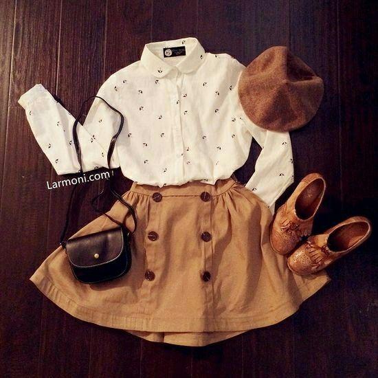Cream and polka-dot dress shirt, tan skirt, brown beret, brown shoes