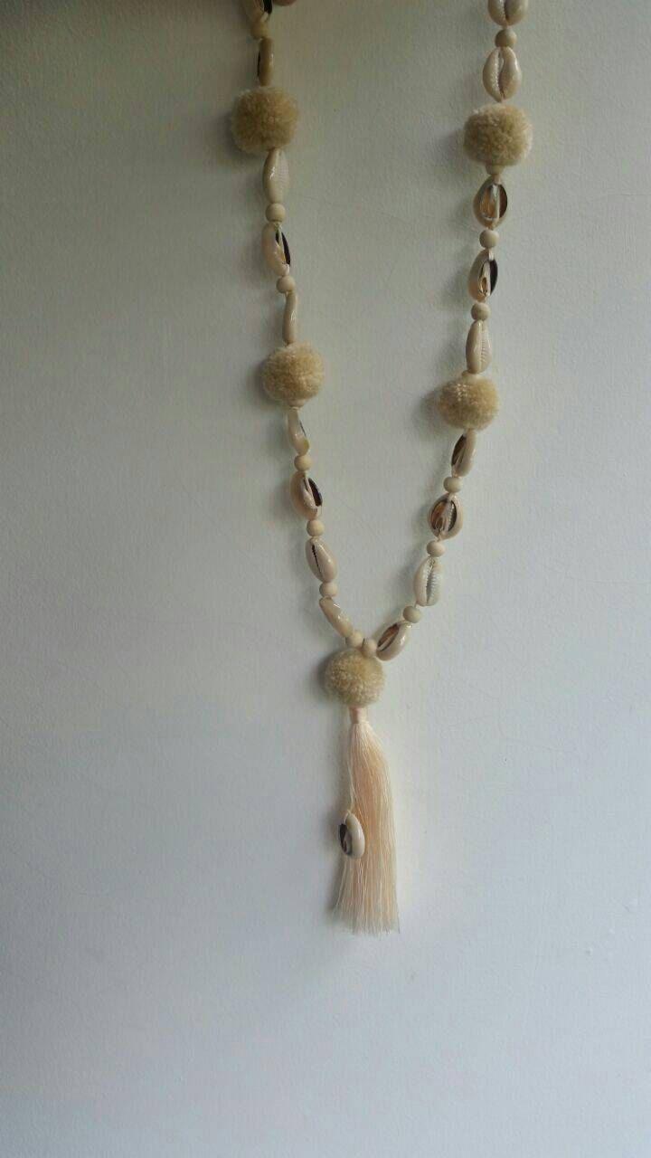 Cowie shell y pom pom collar joyería de concha de Cowie