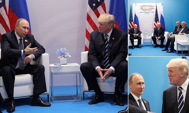Putin denies hacking election as he meets Trump face to face