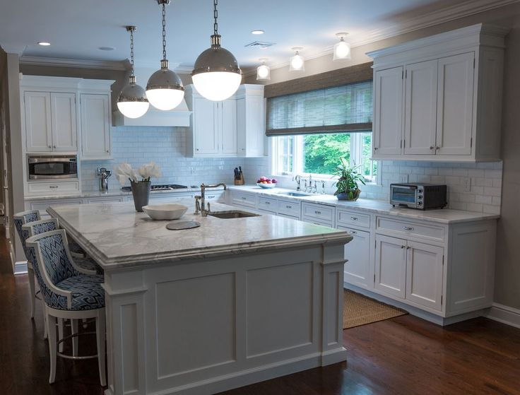 Traditional Kitchen with Pendant Light, Crown molding, Complex marble counters, Custom hood, Fireclay tile oyster shell