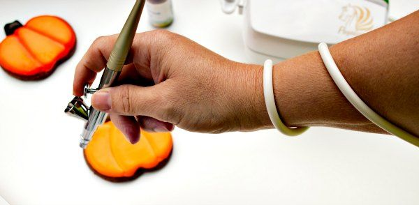 How to Use an Airbrush Gun-wrap the tubing around your arm to keep it from brushing against your item.