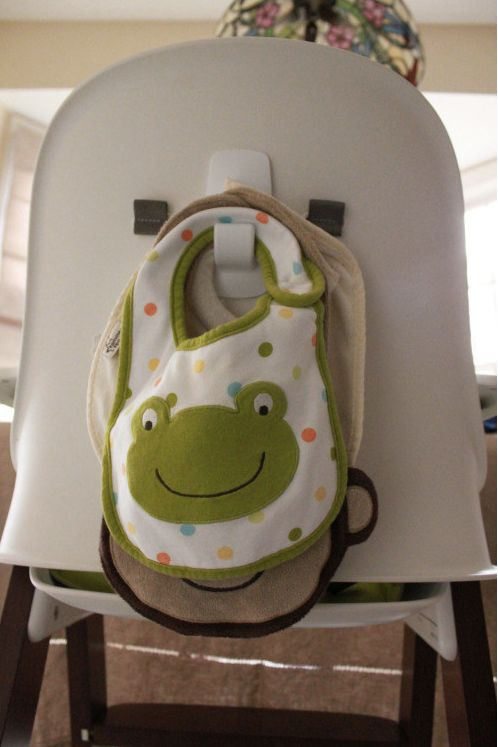 Attach a command hook to the back of your baby's high chair to keeps bibs handy at mealtime.