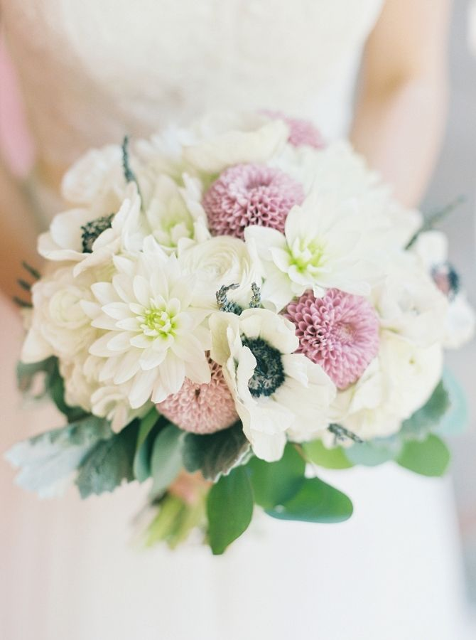 Anemone, dahlia and chrysanthemum wedding bouquet: http://www.stylemepretty.com/2017/05/12/a-gorgeous-estate-wedding-by-the-sea/ Photography: Simply Sarah - http://simplysarah.me/