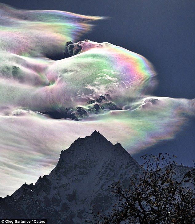 Rainbow cloud caused by sun reflecting from tiny ice crystals inside the cloud's water vapor.