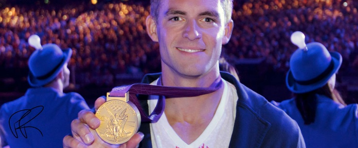 Pete Reed, Great Britain rower, proudly displays his gold medal in the Olympic stadium