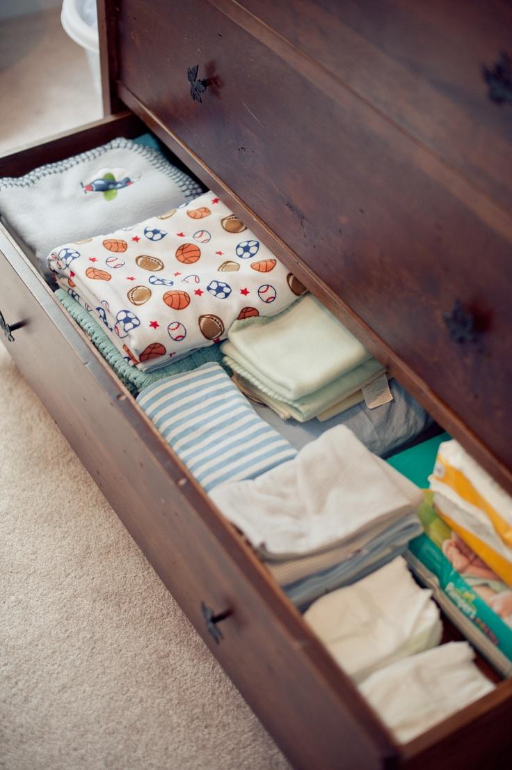 baby dresser organization bottom drawer is blankets, extra diapers, burp cloths, crib sheets etc. www.amandamcmahon.com