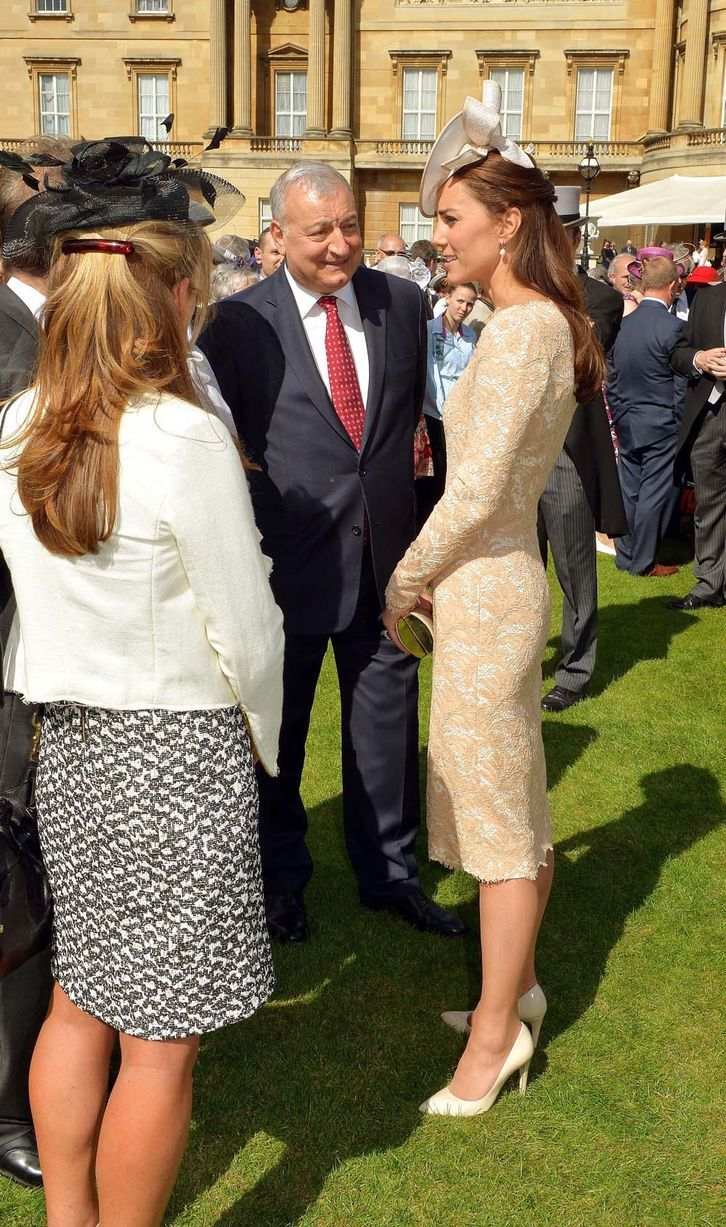 Kate meets guests during a garden party held at Buckingham Palace